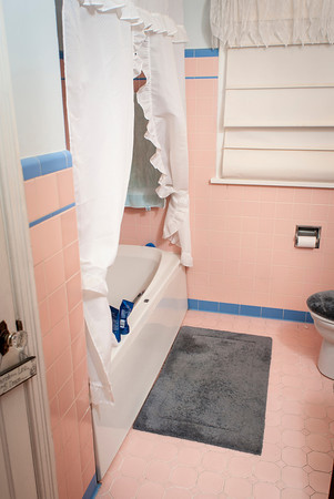 Marla Halbrook has retained the pink and blue tile in the downstairs bath.