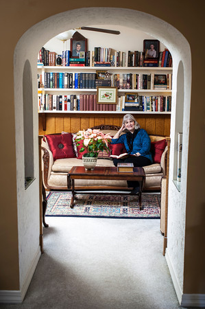A curved arch leads to the library of Linda Hattaway's expansive ranch home on Boston Street.