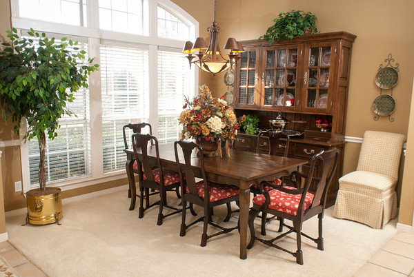 Natural light complements the warm decor of the Goad's formal dining area.