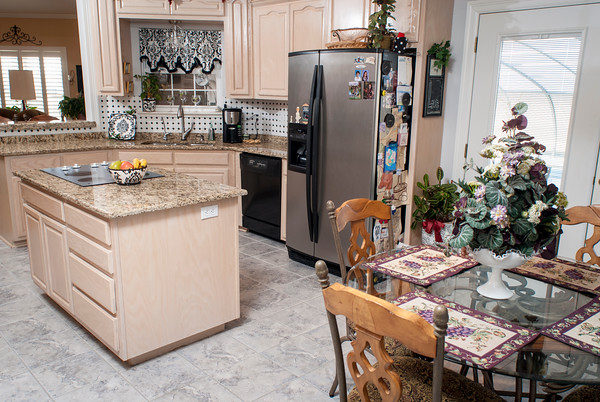 The kitchen cabinets are pickled ash built by Slape Cabinets of Muskogee with Brazilian granite counters from Mill Creek in Tulsa.