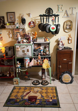 A variety of collectibles and antiques are displayed in the kitchen including items on the green cook stove manufactured<br /> by Buck's ranging from<br /> Pillsbury Doughboys to Nabisco<br /> Cracker tins.