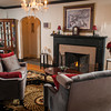The furnishings in the living room are done in silver, black and red.