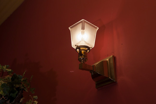 Original wall sconce on the dining room wall. The other fixtures in the room were chosen to match this one.