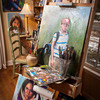 Ann Davis keeps a painting on the late Roger Davis' easel and keeps his palette and brushes as her husband left them.