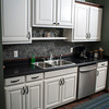 The Haley's kitchen is done with a black countertop, stainless appliances and white cabinets.