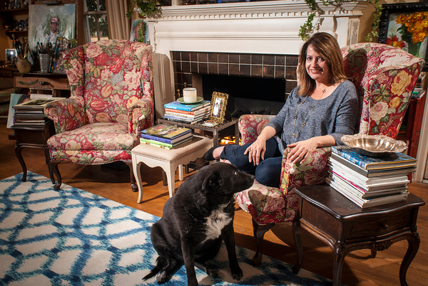 Ann Boos Davis and Lola find a comfortable spot near the fireplace in the living room of her Boston Street home.
