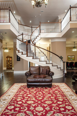 The custom-cut spiral staircase is an architectural piece of art built by Nathan Henegar of Claremore, who along with his sister pieced together the custom woodwork throughout the house.
