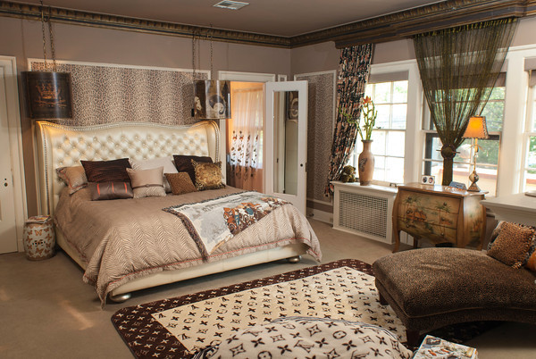 The master bedroom in the Newhouse home features a Hollywood Swank bed by Michael Amini in a leather<br /> champagne color adorned in crystals.