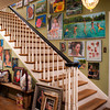The stairwell in the Davis home is a gallery of Roger Davis' work.