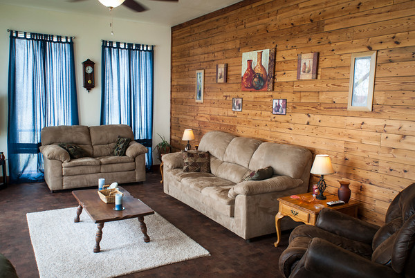 The wood on the paneled wall of the Haley's living room came from the two small homes originally on the site.
