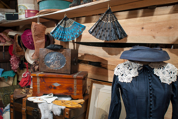 Dresses, hats, fans, shoes and purses are part of the display in the women's area of the mercantile.