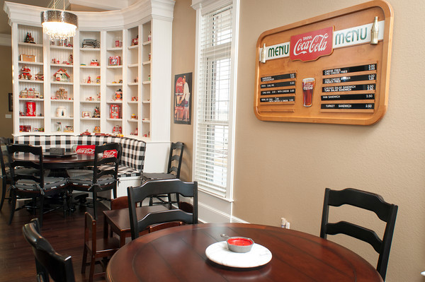 Coca-Cola branded items appear throughout the home, including in this breakfast nook  decorated as a small cafe.
