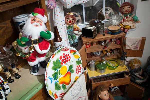 Santa presides over a collection of toy cooking and serving items.