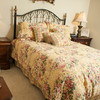 The bedding in one of the guest bedroom sports a floral pattern.