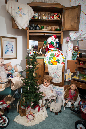 Linda Johnson has held onto her childhood through a wide variety of toys, dolls and stuffed animals displayed in the toy room.