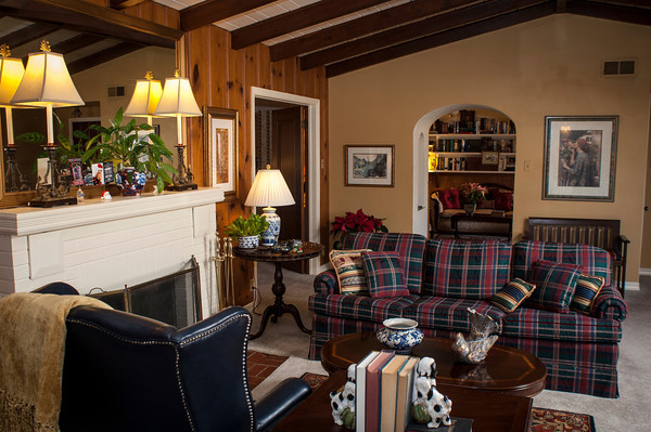 Pine paneling and a large fire place occupy one wall of Linda Hattaway's living room.