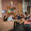Patrons relax in the homey seating area.