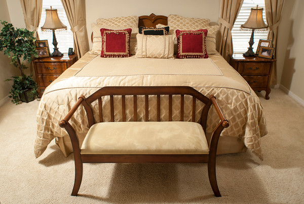 The master suite in the Goad home is done in warm tones keyed off soft gold.