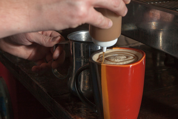 Proprietor Nick Wilks takes pride in offering handcrafted beverages at his downtown coffeehouse.