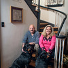 Jim and Marla Halbrook sit on their stairs with the family Rottweilers, Leigha and<br /> Duke.