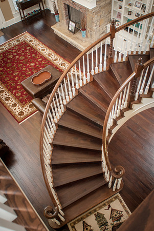 The curving stairway sweeps from the second-floor landing into the spacious living room of the Inhofe home.