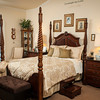 The four-post bedroom group Is well-suited to the cathedral ceiling in the master bedroom.