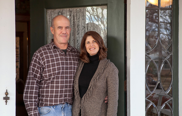 Steve and Juli Grober stand at the entry to their home.