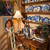 Ann Davis displays her collected china alongside art by her late husband, Roger Davis.