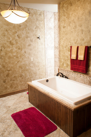 The master bath includes a Jacuzzi tub and a large walk-in shower.