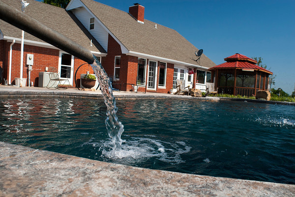 The free-form pool is the centerpiece of the backyard of the Garrett home.