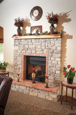 The see-through gas fireplace in the in the living room connects to the kitchen.