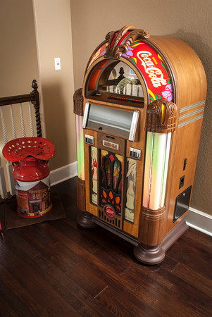 The upstairs jukebox, which plays compact discs, displays the Coca-Cola insignia.