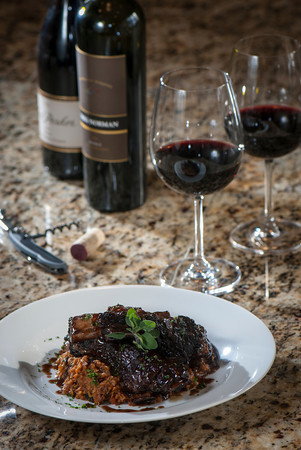 A Greg Norman 2008 shiraz is a wonderful companion to red-wine braised beef spare ribs served over a vegetable quinoa pilaf.