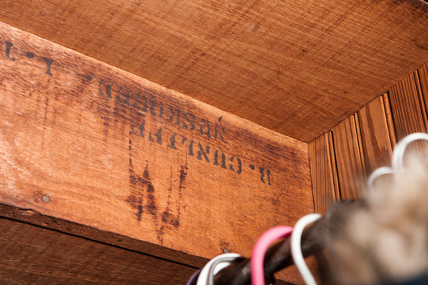 Original stamped lumber under stairs in coat closet.