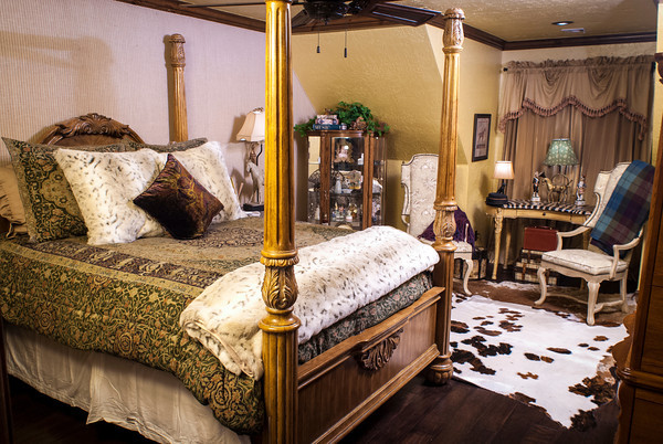 Angela Scott designed the guest room for her son, Michael Hodges. The room has burlap on the walls and a cowhide rug on the floor.