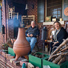 Brian Jones and Andrea Chancellor sit around the chiminea at their home on Boston Street. The side porch has become a conversation spot to visit with neighbors on the cul de sac.