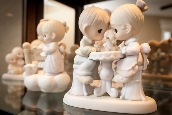 Precious Moments figurines are displayed in a cabinet in the reception room.