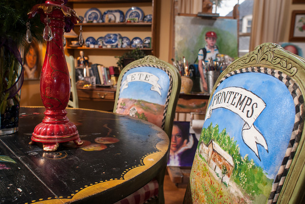 The tables and chairs were painted by Roger Davis. The four chairs are painted with seasonal scenes including the French name for each season.