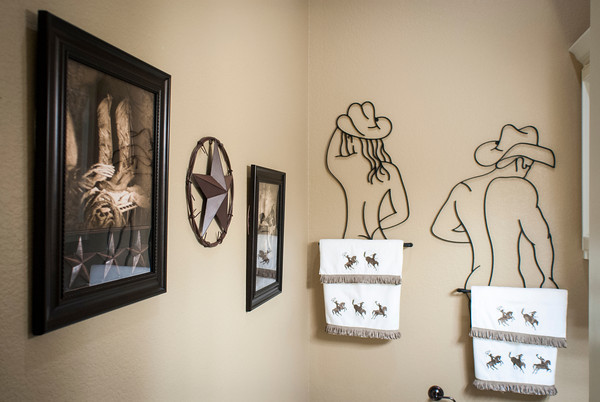 A guest bathroom is decorated in cowboy chic.
