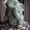 Perhaps a harbinger of spring,  ceramic bunny strikes a thoughtful pose on the porch of the Wright home.