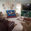 The living room offers plenty of seating and an eclectic mix of items in the decor.