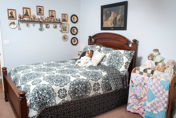 Arlene Humphrey's collectibles room includes Hummels, dolls and Beanie Babies. A quilt rack holds her grandmother¹s quilts.
