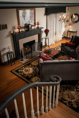 The landing on the curving staircase overlooks the living room of the Halbrook home.