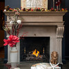 An ornate fireplace decked out for Christmas takes up most of one wall of the small sunroom in Jimmy and Leslie Newhouse's home.