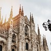 Beautiful Panoramic view of Duomo square in Milan with big street lamp. Italy.