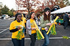 Students sport gold and green accessories at the HOOPLA! Block Party celebrating the opening game for Mason's Women's and Men's basketball teams at Fairfax Campus.