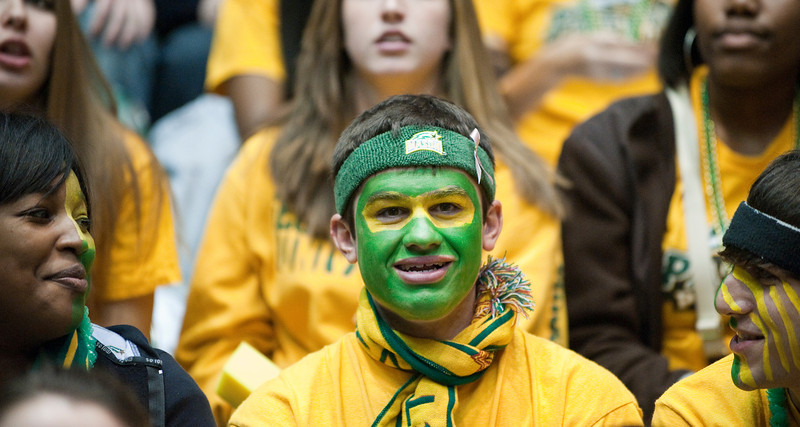 Students  attend the Mason Homecoming 2012 basketball game at the Patriot Center, Fairfax Campus. Photo by Alexis Glenn/Creative Services/George Mason University