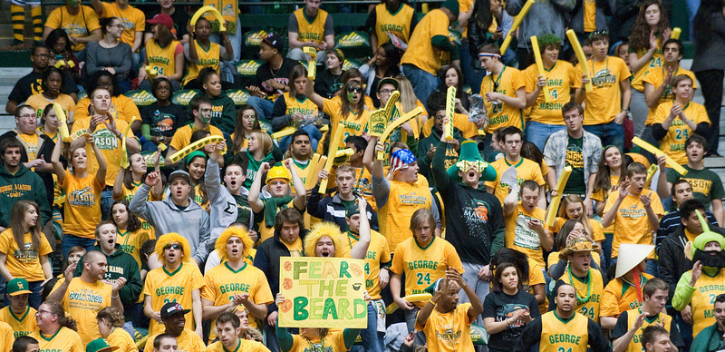 The student section is seen filled with spirited fans at the Mason Homecoming 2012 basketball game at the Patriot Center, Fairfax Campus. Photo by Alexis Glenn/Creative Services/George Mason University