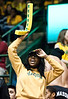 A student cheers at the Mason Homecoming 2012 basketball game at the Patriot Center, Fairfax Campus. Photo by Alexis Glenn/Creative Services/George Mason University