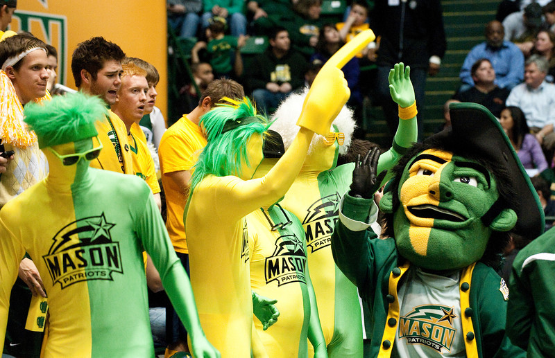 The Mason G-Men high five the Patriot during the Mason Homecoming 2012 basketball game at the Patriot Center, Fairfax Campus. Photo by Alexis Glenn/Creative Services/George Mason University
